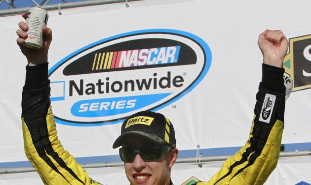 Brad Keselowski celebrates after winning the NASCAR Nationwide Series auto race at New Hampshire Motor Speedway Saturday, July 12, 2014, in Loudon, N.H. (AP Photo/Jim Cole)