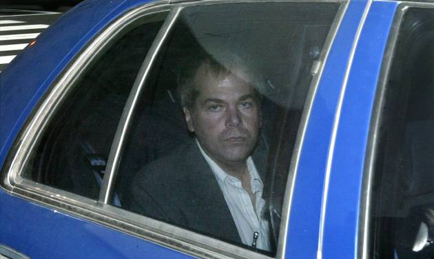 FILE - In this Nov. 18, 2003 file photo, John Hinckley Jr. arrives at U.S. District Court in Washington. Hinckley, who shot President Ronald Reagan in 1981 has behaved well over the past year when he's been freed from a Washington mental hospital to visit his mother in Virginia, according to U.S. Secret Service reports. (AP Photo/Evan Vucci, File)