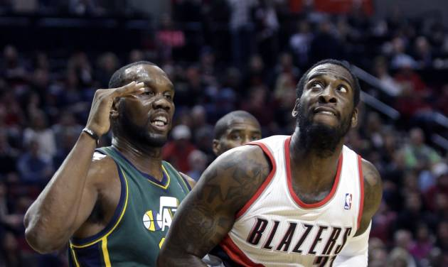 Portland Trail Blazers center J.J. Hickson, right, looks to shoot against Utah Jazz center Al Jefferson during the first quarter of an NBA basketball game in Portland, Ore., Saturday, Feb. 2, 2013.(AP Photo/Don Ryan)