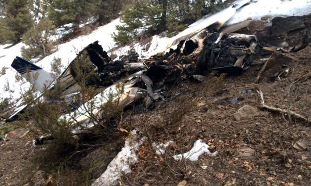 This photo released by the San Miguel Sheriff's Office shows the wreckage of a private Beechcraft Bonanza single-engine plane that crashed near a Colorado ski town's airport, killing all three people aboard. Sheriff's spokeswoman Jennifer Dinsmore said deputies began the recovery effort west of Telluride, Colo., Monday Feb. 17, 2014. The airplane took off from Telluride Regional Airport on Sunday, Feb. 16 on its way to Cortez, a city in southwest Colorado about 75 miles away. (AP Photo/San Miguel Sheriff's Office)