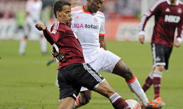 FILE - In this Nov. 17, 2012, file photo, Nuremberg's Timothy Chandler of the U.S., left, and Bayern's David Alaba of Austria, right, challenge for the ball during a soccer match in Nuremberg, southern Germany.  U.S. team coach Jurgen Klinsman named  Chandler to the team's 30-man preliminary roster on Monday May 12, 2014. (AP Photo/Jens Meyer, File)