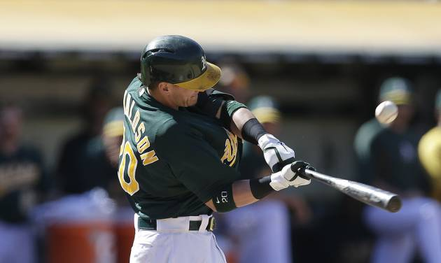 Oakland Athletics' Josh Donaldson connects for the game winning-single in the 11th inning of a baseball game against the Boston Red Sox on Sunday, July 14, 2013, in Oakland, Calif. The A's won 3-2. (AP Photo/Ben Margot)