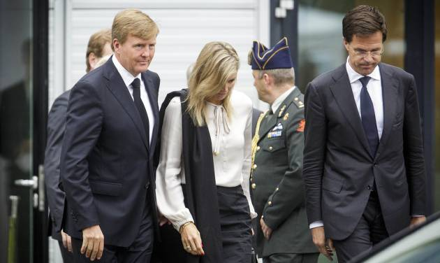 """Dutch King Willem-Alexander, left, Queen Maxima, center, and Dutch Prime Minister Mark Rutte, far right, leave a meeting in Nieuwegein, near the central city of Utrecht, Netherlands, Monday, July 21, 2014. Relatives of Dutch victims killed in the downing of Malaysia Airlines Flight 17 were meeting Monday afternoon with their king, queen and prime minister amid growing anger at the treatment of their loved ones' bodies by pro-Russian rebels in Ukraine. In an unusual move that underscored the severity of the national trauma, a somber King Willem-Alexander gave a brief televised address to his country after meeting grieving relatives. """"This terrible disaster has left a deep wound in our society,"""" the king said. """"The scar will be visible and tangible for years to come."""" (AP Photo/Phil Nijhuis)"""