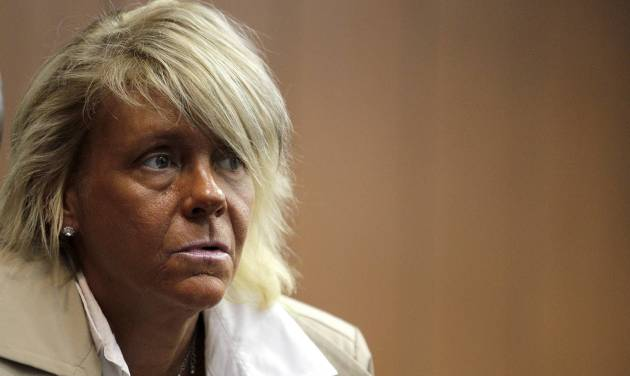 """FILE - In this May 2, 2012 file photo, Patricia Krentcil, 44, waits to be arraigned at the Essex County Superior Court in Newark, N.J., where she appeared on charges of endangering her 5-year-old child by taking her into a tanning salon. A grand jury in New Jersey has decided to let Krentcil a woman who gained overnight notoriety as """"the tanning mom"""" bronze away in peace. Prosecutors in Newark said Tuesday, Feb. 26, 2013 a grand jury refused to indict Patricia Krentcil on a charge she took her young daughter into a tanning booth with her. (AP Photo/Julio Cortez, File)"""