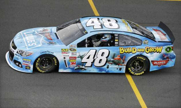 Jimmie Johnson drives into the pits after qualifying for Sunday's NASCAR Sprint Cup Series auto race, Friday Aug. 2, 2013, in Long Pond, Pa.  Johnson qualified on the pole with a speed of 180.654 mph. (AP Photo/Mel Evans)