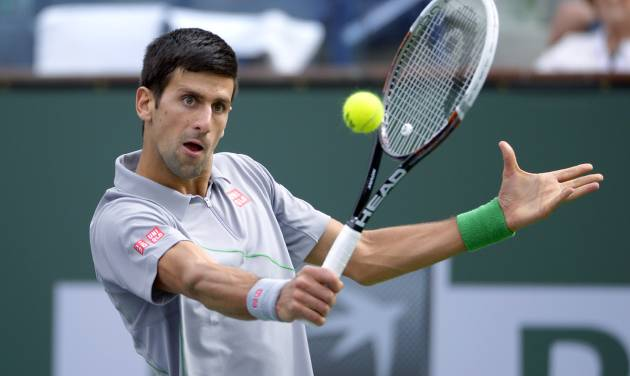Novak Djokovic, of Serbia, returns a shot to Alejandro Gonzalez, of Colombia, in a third round match at the BNP Paribas Open tennis tournament, Tuesday, March 11, 2014, in Indian Wells, Calif. (AP Photo/Mark J. Terrill)
