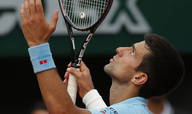 Serbia's Novak Djokovic reacts as he plays Spain's Rafael Nadal during their final match of  the French Open tennis tournament at the Roland Garros stadium, in Paris, France, Sunday, June 8, 2014. (AP Photo/Michel Euler)