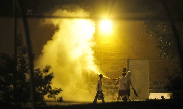 Teenagers spray a fire extinguisher at the Woodland Hills Youth Development Center in Nashville, Tenn., early Thursday, Sept. 4, 2014. More than two dozen teens created a large disturbance Wednesday night in the yard of a detention center with a long history of violence, escape attempts and sexual-abuse allegations. Two days earlier, 32 teens escaped from the facility. (AP Photo/The Tennessean, Jason S. Lee)