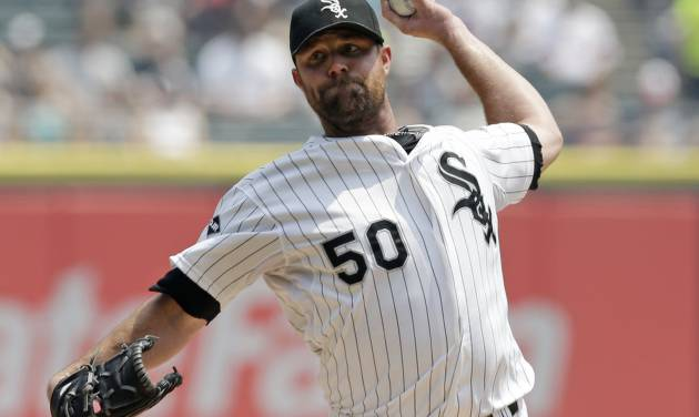 Chicago White Sox starter John Danks throws against the Houston Astros during the first inning of a baseball game in Chicago on Sunday, July 20, 2014. (AP Photo/Nam Y. Huh)