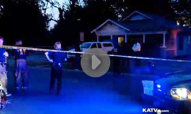 In an image made from video provided by KATV, police surround a home in Pine Bluff, Ark., Saturday, Sept. 7, 2013 during a standoff that left an elderly man dead. Lt. David Price told KATV that when officers arrived at the home they learned that an aggravated assault had occurred against two people. Arkansas SWAT officers shot and killed the suspect, Monroe Isadore, who authorities say is 107-year-old old, when he pointed a weapon at them. (AP Photo/courtesy of KATV)