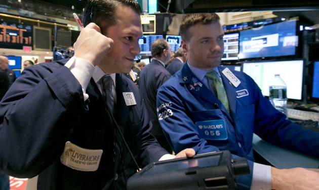Trader Michael Zicchinolfi, left, and specialist Frank Masiello work on the floor of the New York Stock Exchange, Thursday, April 3, 2014. Stocks indexes are edging higher as investors become more optimistic about the outlook for the U.S. economy. (AP Photo/Richard Drew)
