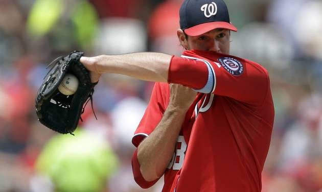 Washington Nationals starting pitcher Doug Fister wipes his face during the second inning of a baseball game against the St. Louis Cardinals, Sunday, June 15, 2014, in St. Louis. (AP Photo/Jeff Roberson)