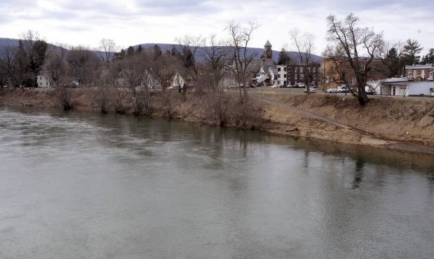 The west branch of the Susquehanna River flows past Jersey Shore, Pa. on Sunday March 23, 2014. About a third of the borough (population 4,300) is in a flood hazard zone and nearly 470 homes in town are expected to see flood insurance premium hikes because of changes to the National Flood Insurance Program. (AP Photo/Ralph Wilson)