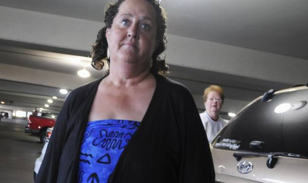 In this photo taken Thursday, April 26, 2012, Lise Sievers of Red Wing, Minn., talks about the experience she had about an hour earlier, when she was quarantined inside a Delta Airlines flight from Detroit to Midway International Airport in Chicago. Sievers was showing symptoms of bug bites she acquired while visiting Africa, and all the passengers on the Chicago-bound flight were kept in the plane until medical officials gave the clearance to disembark. On Friday, April 27 her son, Roger Sievers, explained how one comment got misunderstood and one thing led to another until the situation began to resemble a scene from a science fiction movie. (AP Photo/Chicago Sun-Times, John J. Kim)CHICAGO LOCALS OUT, MAGS OUT