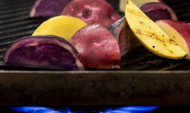 For a wonderful smoky flavor, put potato halves in a microwave-safe bowl; microwave, covered, until just tender. Cool slightly; coat lightly with olive oil. Grill 5 to 7 minutes, turning occasionally. (Bill Hogan/Chicago Tribune/MCT)