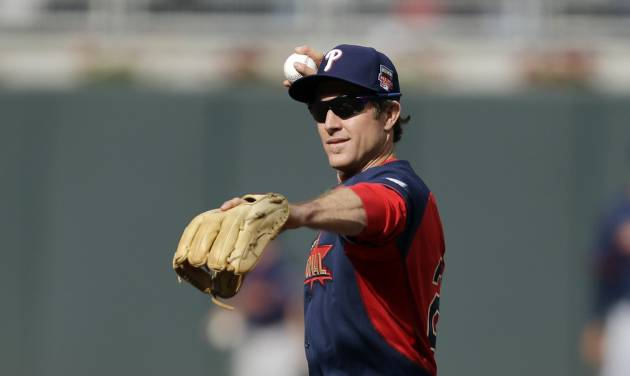 National League infielder Chase Utley, of the Philadelphia Phillies, throws during batting practice for the MLB All-Star baseball game, Monday, July 14, 2014, in Minneapolis. (AP Photo/Jeff Roberson)