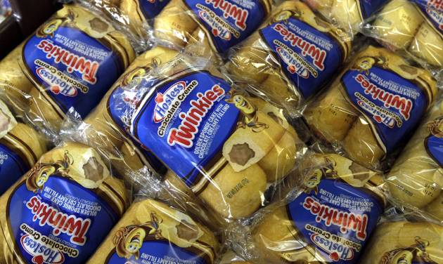 FILE - In this Friday, Nov. 16, 2013, file photo, Twinkies baked goods are displayed for sale at the Hostess Brands' bakery in Denver, Colo. A bankruptcy judge on Tuesday approved the sale of Twinkies to a pair of investment firms, one of which has said it hopes to have the cakes back on shelves by summer. (AP Photo/Brennan Linsley, File)