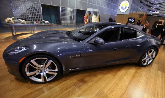FILE - This Nov. 18, 2010 file photo shows the Fisker Automotive's Fisker Karma, a sports luxury plug-in hybrid car at the 2010 Los Angeles Auto Show in Los Angeles. A Delaware bankruptcy judge on Friday ordered a competitive auction for the assets of Fisker Automotive, rejecting a proposal by a group led by Hong Kong billionaire Richard Li to assume control of the failed electric auto manufacturer in a private sale.  (AP Photo/Damian Dovarganes, File)
