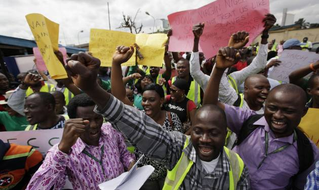 """Former Air Nigeria staff protest after they were fired in Lagos, Nigeria, Friday, Sept. 7, 2012. More than 60 workers from Air Nigeria protested Friday at Lagos' Murtala Muhammed International Airport's domestic terminal, demanding four-months-worth of unpaid salaries from the company. The airline's owner, business tycoon Jimoh Ibrahim, fired nearly all of the company's 800 employees for """"disloyalty"""" earlier this month. (AP Photo/Sunday Alamba)"""