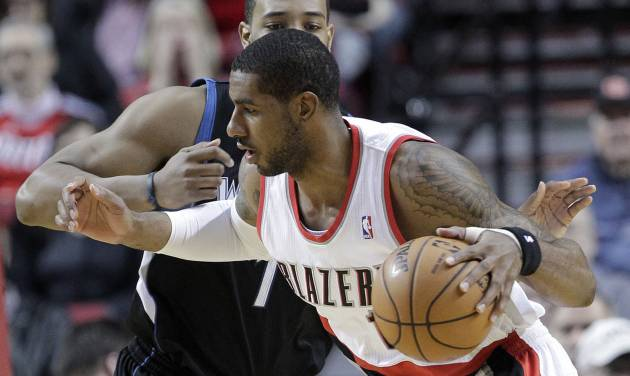 Portland Trail Blazers forward LaMarcus Aldridge, right, works his way inside against Minnesota Timberwolves forward Derrick Williams during the first quarter of an NBA basketball game in Portland, Ore., Saturday, March 2, 2013. (AP Photo/Don Ryan)