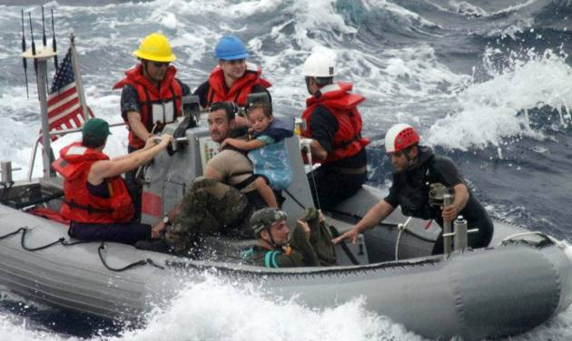 In this photo provided by the U.S. Coast Guard, sailors from Oliver Hazard Perry-class frigate USS Vandegrift (FFG 49) assist in the rescue of a family with a sick infant via the ship's small boat as part of a joint U.S. Navy, Coast Guard and California Air National Guard rescue effort, Sunday, April 6, 2014. Eric and Charlotte Kaufman said their daughter Lyra's medical condition continued to improve after they boarded the San Diego-bound Vandegrift hundreds of miles off the Mexican coast so the girl could get to a medical facility. (AP Photo/U.S. Coast Guard)