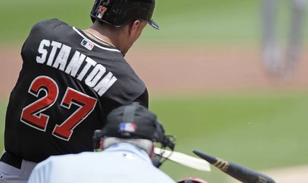Miami Marlins' Giancarlo Stanton (27) breaks his bat as he hits in the first inning of a baseball game against the St. Louis Cardinals, Sunday, July 6, 2014 in St. Louis. (AP Photo/Tom Gannam)