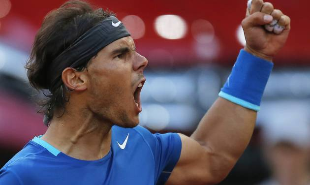 Rafael Nadal from Spain celebrates a point during a Madrid Open tennis tournament final match against Kei Nishikori from Japan in Madrid, Spain, Sunday, May 11, 2014. (AP Photo/Andres Kudacki)