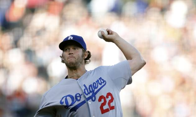 Los Angeles Dodgers starting pitcher Clayton Kershaw winds up during the third inning of a baseball game against the San Francisco Giants, Saturday, July 26, 2014, in San Francisco. (AP Photo/Beck Diefenbach)