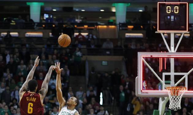 Cleveland Cavaliers' Earl Clark (6) fails to make a 3-pointer over Boston Celtics' Avery Bradley (0) with no time left on the clock in the fourth quarter of an NBA basketball game in Boston, Saturday, Dec. 28, 2013. The Celtics won 103-100. (AP Photo/Michael Dwyer)