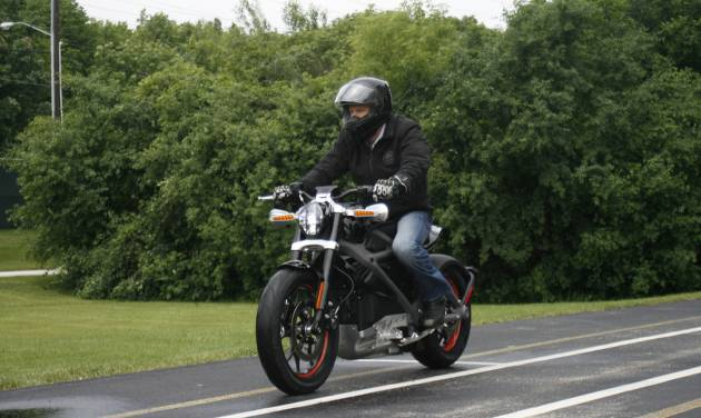 In this Wednesday, June 18, 2014 photo, employee Ben Lund demonstrates Harley's new electric motorcycle at Harley's research facility in Wauwatosa, Wis. The company plans to unveil the LiveWire model Monday, June 23, at an invitation-only event in New York. (AP Photo/M.L. Johnson)