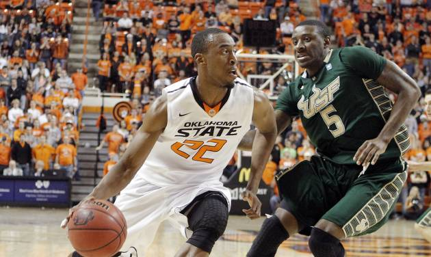 OKLAHOMA STATE UNIVERSITY BASKETBALL / OSU: Oklahoma State's Markel Brown (22) drives past South Florida Bulls' Jawanza Poland (5) during the college basketball game between Oklahoma State University (OSU) and the University of South Florida (USF) on Wednesday , Dec. 5, 2012, in Stillwater, Okla.   Photo by Chris Landsberger, The Oklahoman