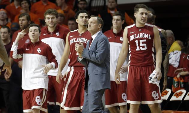 OU coach Lon Kruger, center, knows a win over any conference team, including struggling Oklahoma State, will help OU make a second consecutive NCAA Tournament. Photo by Sarah Phipps, The Oklahoman