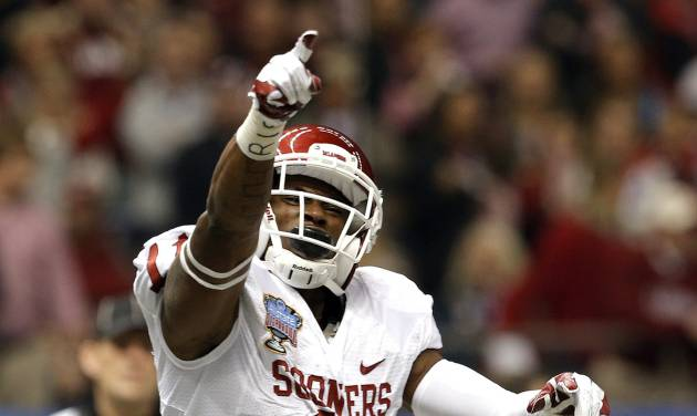 Oklahoma's Lacoltan Bester (11) celebrates a touchdown during the NCAA football BCS Sugar Bowl game between the University of Oklahoma Sooners (OU) and the University of Alabama Crimson Tide (UA) at the Superdome in New Orleans, La., Thursday, Jan. 2, 2014. Photo by Sarah Phipps, The Oklahoman