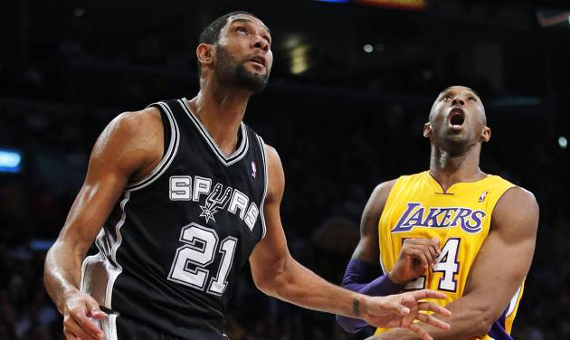 Los Angeles Lakers' Kobe Bryant (24) and San Antonio Spurs' Tim Duncan (21) watch a shot by Duncan in the first half of an NBA basketball game in Los Angeles, Tuesday, Nov. 13, 2012. (AP Photo/Jae C. Hong)