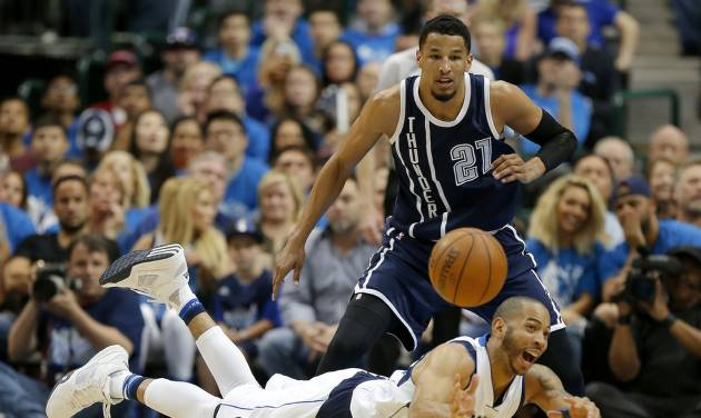 Dallas' Devin Harris (34) passes the ball as he falls in front of Oklahoma City's Andre Roberson (21) during Game 4 of the first round series between the Oklahoma City Thunder and the Dallas Mavericks in the NBA playoffs at American Airlines Center in Dallas, Saturday, April 23, 2016. Oklahoma City won 119-108. Photo by Bryan Terry, The Oklahoman