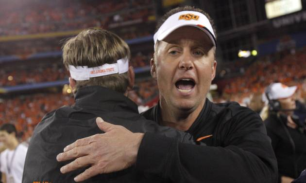 COLLEGE FOOTBALL / CELEBRATION: Oklahoma State coach Mike Gundy celebrates after winning the Fiesta Bowl between the Oklahoma State University Cowboys (OSU) and the Stanford Cardinals at the University of Phoenix Stadium in Glendale, Ariz., Monday, Jan. 2, 2012. Photo by Bryan Terry, The Oklahoman