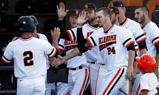 The Oklahoma State bench congratulates Tim Arakawa (2) as he returns from scoring a run during a NCAA college baseball game between Oklahoma State University (OSU) and Arizona State University at Allie P. Reynolds stadium in Stillwater, Okla., Friday, May 2, 2014. Photo by KT King, The Oklahoman