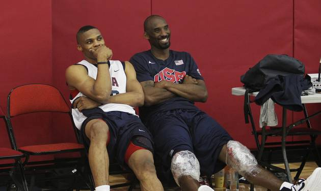 USA men's basketball national team members Russell Westbrook, left, hangs out with teammate Kobe Bryant after practice at the Mendenhall Center on the UNLV campus in Las Vegas on Friday, July 6, 2012. (AP Photo/Las Vegas Review-Journal, Jason Bean) ORG XMIT: NVLAS209