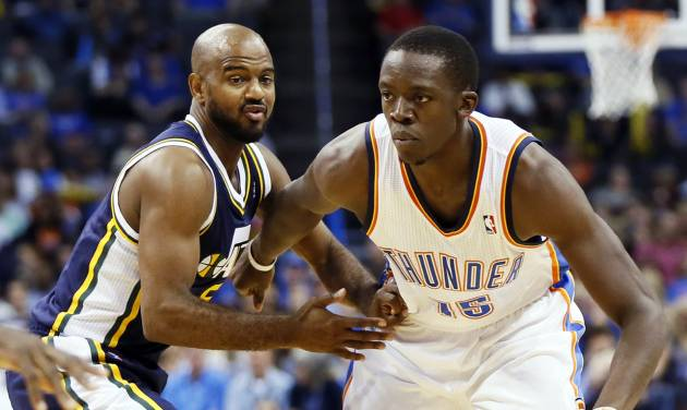 Oklahoma City's Reggie Jackson (15) drives the ball against Utah's John Lucas III (5) during a preseason NBA basketball game between the Oklahoma City Thunder and the Utah Jazz at Chesapeake Energy Arena in Oklahoma City, Sunday, Oct. 20, 2013. Photo by Nate Billings, The Oklahoman