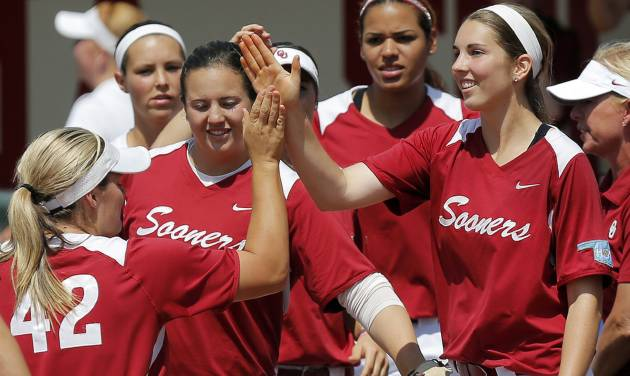 The OU Sooners, including Kelsey Stevens (18), right, and Georgia Casey (42), celebrate during the final game of the Norman Regional in 2014 NCAA softball championship between Oklahoma and Texas A&M in Norman, Okla., Sunday, May 18, 2014. OU won 11-6. Photo by Nate Billings, The Oklahoman