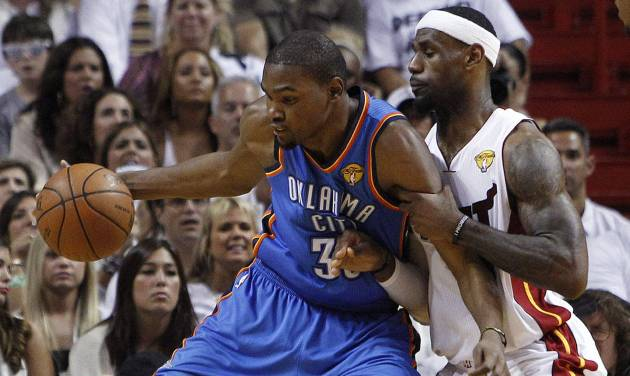 FILE - In this June 21, 2012, file photo,Oklahoma City Thunder small forward Kevin Durant (35) works the ball against Miami Heat small forward LeBron James (6) during the first half at Game 5 of the NBA finals basketball series in Miami. Durant and James will team-up for the USA in this summer's Olympics. (AP Photo/Lynne Sladky, File)