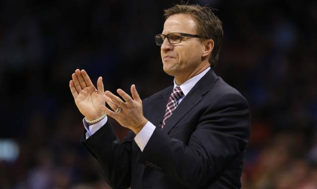 Oklahoma City coach Scott Brooks claps during an NBA basketball game between the Oklahoma City Thunder and the Golden State Warriors at Chesapeake Energy Arena in Oklahoma City, Friday, Jan. 17, 2014. Oklahoma City won 127-121. Photo by Bryan Terry, The Oklahoman