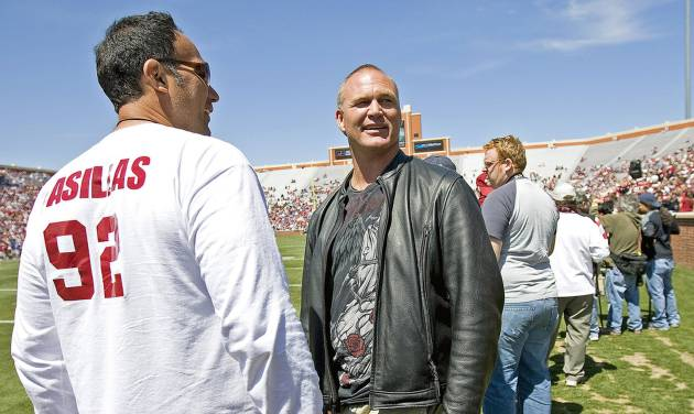 SPRING FOOTBALL GAME: Former OU players Brian Bosworth, right, and  Tony Casillas watch during the University of Oklahoma's Red-White college football game at The Gaylord Family -- Oklahoma Memorial Stadium in Norman, Okla., Saturday, April 11, 2009. Photo by Bryan Terry, The Oklahoman ORG XMIT: KOD