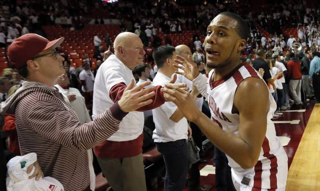 Oklahoma's Jordan Woodard, a former Edmond Memorial standout, celebrates with fans after Monday's Bedlam victory. Woodard led OU with 18 points. Photo by Nate Billings, The Oklahoman