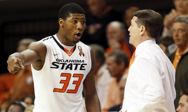 Oklahoma State's Marcus Smart (33) talks with head coach Travis Ford during an NCAA men's college basketball game between Oklahoma State University (OSU) and West Virginia at Gallagher-Iba Arena in Stillwater, Okla., Saturday, Jan. 26, 2013. Photo by Nate Billings, The Oklahoman