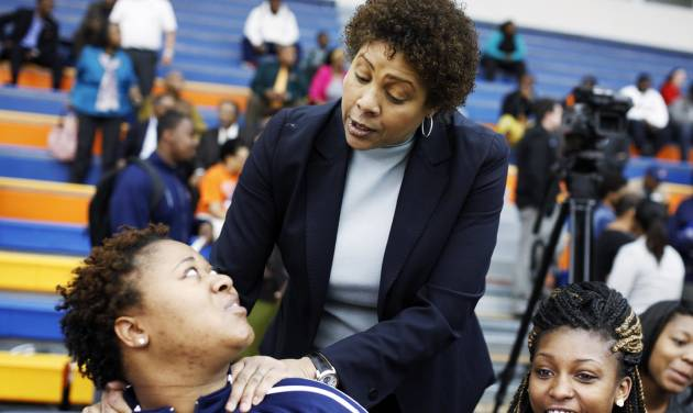 Women's basketball great Cheryl Miller speaks to players Alex Adekunle (left) and Kashyla Fields (right) before the beginning of a press conference where she was introduced as the head coach of Langston's women's basketball program on Tuesday, April 29, 2014 Photo by KT King, The Oklahoman