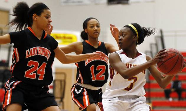 Nakylia Carter (3) of Putnam City North looks to pass away from Kaylan Mayberry (12) and MiKayla Alexander (24) of Booker T. Washington during the championship game of the Lady Jag Classic girls basketball tournament between Booker T. Washington and Putnam City North at Westmoore High School in Oklahoma City, Saturday, Jan. 12, 2013. Photo by Nate Billings, The Oklahoman