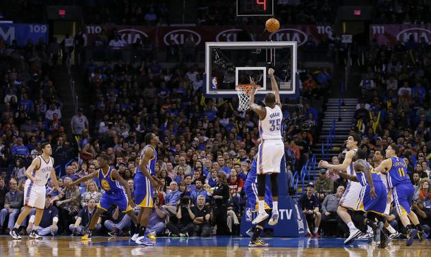 Oklahoma City's Kevin Durant (35) shoots a basket during an NBA basketball game between the Oklahoma City Thunder and the Golden State Warriors at Chesapeake Energy Arena in Oklahoma City, Friday, Jan. 17, 2014. Oklahoma City won 127-121. Photo by Bryan Terry, The Oklahoman