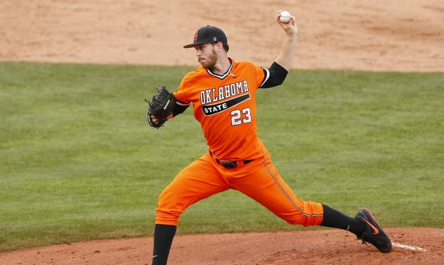 Oklahoma State starting pitcher Michael Freeman delivers in the second inning of the championship game against TCU in the Big 12 conference NCAA college baseball tournament in Oklahoma City, Sunday, May 25, 2014. (AP Photo/Alonzo Adams)