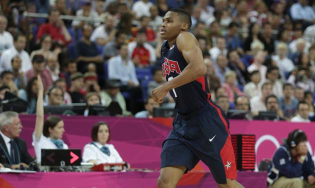 United States' Russell Westbrook hobbles off the court as he leaves the game against Argentina during a men's semifinals basketball game at the 2012 Summer Olympics, Friday, Aug. 10, 2012, in London. (AP Photo/Charles Krupa) ORG XMIT: OBKO149